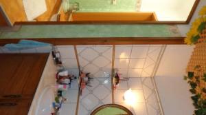 e baño vertikal